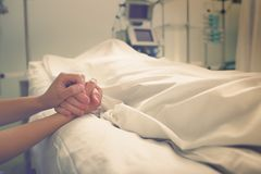 Woman mourns her husband, who died in a hospital.  Royalty Free Stock Image