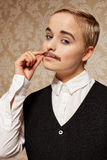Woman with moustache. Woman pretending to be a man with moustache royalty free stock image