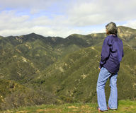 Woman on a moutain overlook Royalty Free Stock Image