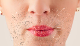 Woman mouth blowing hand drawn icons and symbols close up Stock Photo