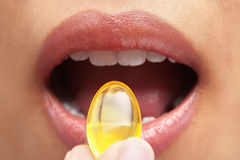 Woman mouth and capsule Stock Images