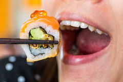 Woman mouth eat sushi Royalty Free Stock Images