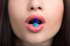 Woman mouth with pill Royalty Free Stock Image