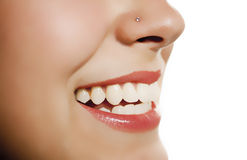 Woman mouth smiling showing tooth. Over white background Stock Photos