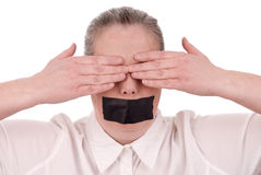 Woman with mouth taped. And hands over her eyes closed over a white background royalty free stock image