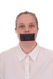 Woman with mouth taped. Closed over a white background stock image