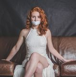 Woman with mouth taped shut Stock Images