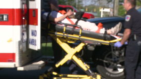 Woman moved by stretcher into ambulance