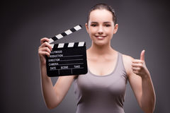 The woman with movie board in cinema concept Royalty Free Stock Photo