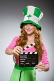 Woman with movie board in saint Royalty Free Stock Photography