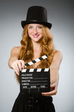 Woman with movie board Stock Photo