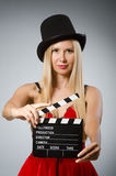 Woman with movie board wearing Royalty Free Stock Photography