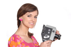 Woman with movie camera Stock Photos
