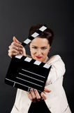 Woman with movie clap Stock Photo