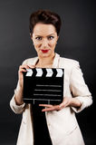 Woman with movie clap very happy Stock Image