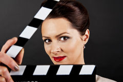 Woman with movie clap close up Royalty Free Stock Images