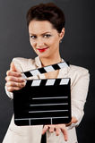 Woman with movie clap close up Stock Images