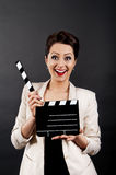 Woman with movie clap very happy Royalty Free Stock Image