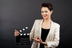 Woman with movie clap Stock Image
