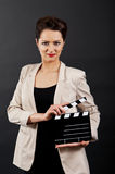 Woman with movie clap Stock Images