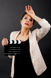 Woman with movie clap over black background Royalty Free Stock Photo