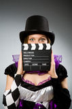 Woman with movie clapboard Royalty Free Stock Photos