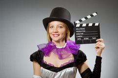 Woman with movie clapboard. Against grey background Stock Photos
