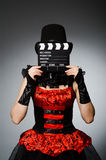 Woman with movie clapboard against Royalty Free Stock Photography