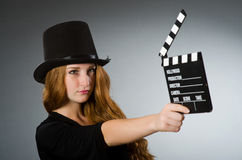 Woman with movie clapboard against Royalty Free Stock Photo