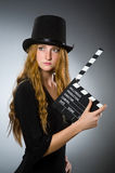 Woman with movie clapboard against Stock Images