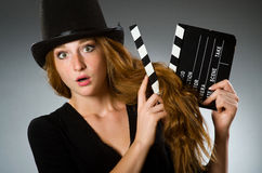 Woman with movie clapboard against. Grey background Stock Photography