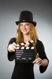 Woman with movie clapboard against Stock Photos