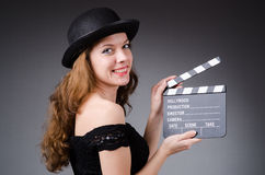 Woman with movie clapper Royalty Free Stock Photo