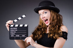 Woman with movie. Clapper board Stock Photography
