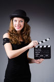 Woman with movie clapper board Royalty Free Stock Image