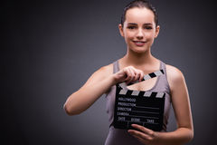 The woman with movie clapper on gray background Stock Images