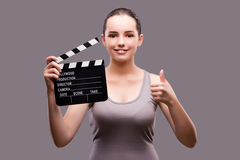 The woman with movie clapper on gray background Royalty Free Stock Images