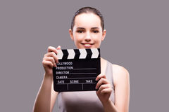 The woman with movie clapper on gray background Stock Photography