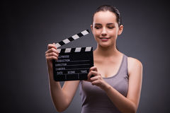 The woman with movie clapper on gray background Royalty Free Stock Image