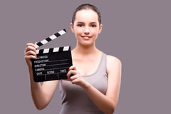 The woman with movie clapper on gray background Stock Photo