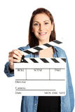 Woman with movie slate Royalty Free Stock Photography