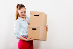Woman moving into apartment house carrying boxes. Stock Photography