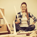 Woman moving into apartment house. Stock Photography