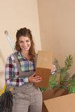 Woman with moving box in her hands Stock Images