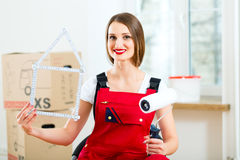 Woman with moving box in her house stock photos