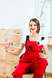 Woman with moving box in her house Royalty Free Stock Photography