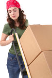 Woman with Moving Boxes. A pretty woman moving and shipping using a two wheel push cart Royalty Free Stock Photography