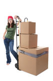 Woman with Moving Boxes. A pretty woman moving and shipping using a two wheel push cart Stock Photos