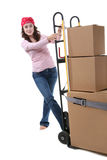 Woman with Moving Boxes. A pretty woman moving and shipping using a two wheel push cart Stock Image