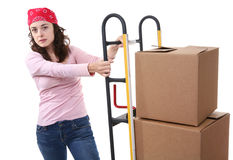Woman with Moving Boxes. A pretty woman moving and shipping using a two wheel push cart Royalty Free Stock Images